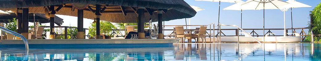 The Swimming Pool and Pool Bar at El Oceano Beachfront Hotel